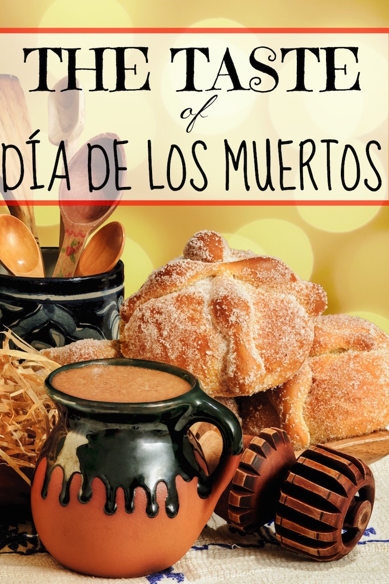 Jar of hot chocolate and sweet bread pan de muerto with wooden chocolate grinder and spoons on festive background