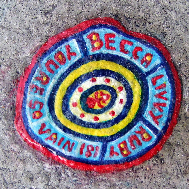 Chewing gum art painted blue, red and yellow and the name's Becca, Livey, Ruby and You're So Vain