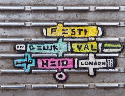 Chewing gum art painted yellow, blue and pink with the word London