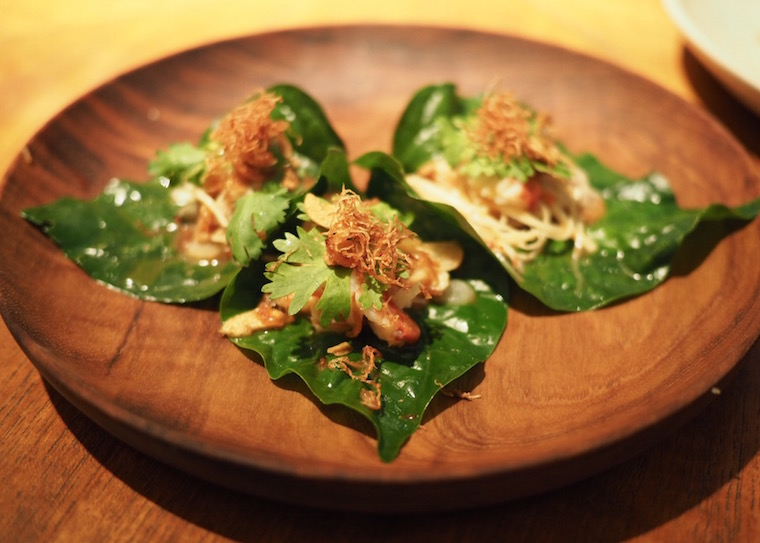 Three canapes from Nahm, Bangkok - Pork and lobster with shredded ginger and Thai citron, each on a green betel leaf