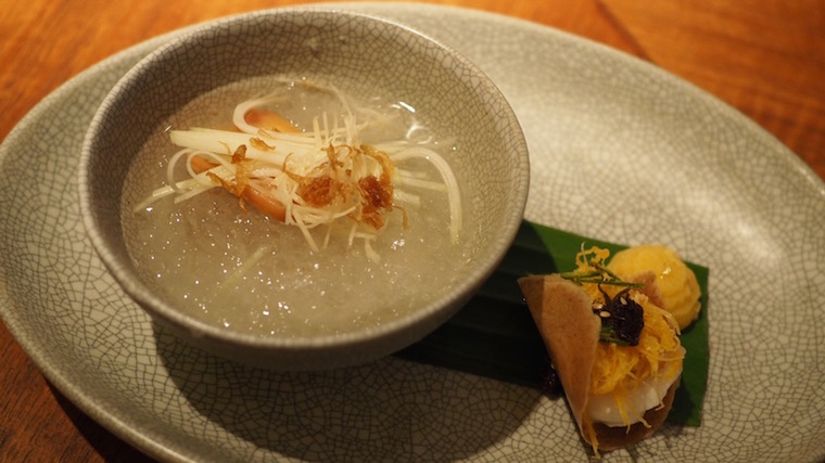 Ice with syrup, persimmon and shallot, and a sweet Thai wafer with poached persimmon and golden duck egg noodles - dessert at Nahm, Bangkok