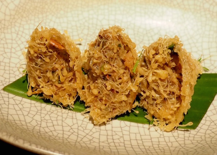 Three triangles of egg nets with prawns, wild almonds and kaffir lime from Nahm, Bangkok