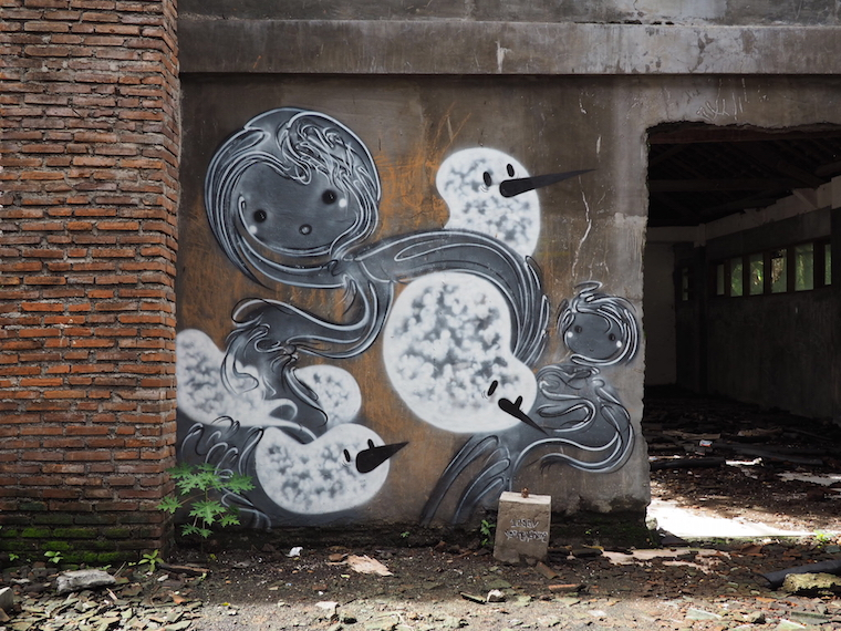 Artwork by 1escv at the abandoned theme park in Bali